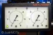 A photo of the dials of an item of MOT test equipment at Just MOTs of Milton Keynes